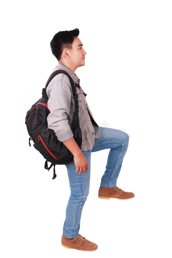 Side View Male Asian Student Stepping Forward royalty free stock photography