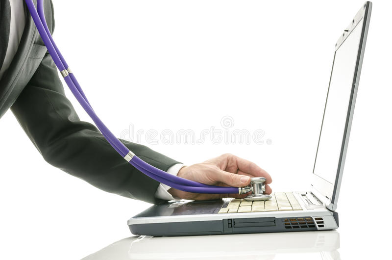 Side view of male hand checking laptop with stethoscope royalty free stock photo