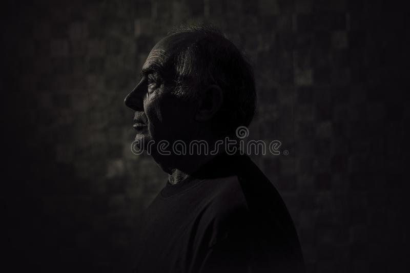 Side View of a Man in Black Top royalty free stock images