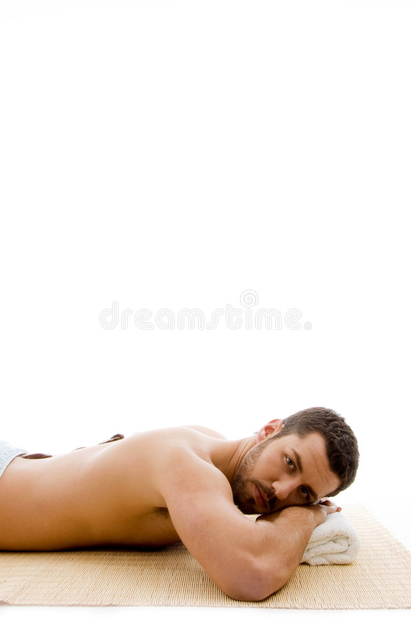 Download Side View Of Man Lying Down On Mat At Spa Royalty Free Stock Photo - Image: 7417655