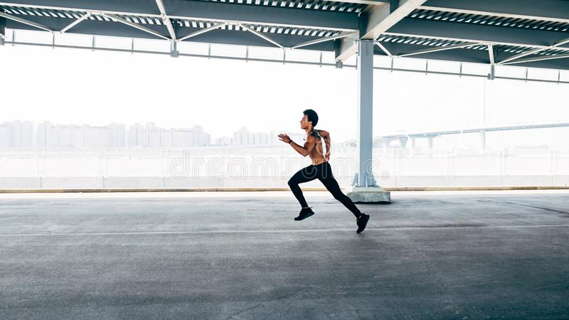 Side view of man sprinting royalty free stock photo