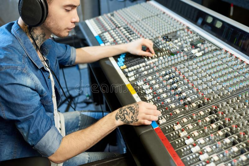 Man creating music in recording studio royalty free stock images