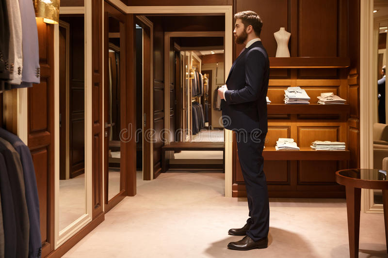 Side view of man tries on a suit stock photo