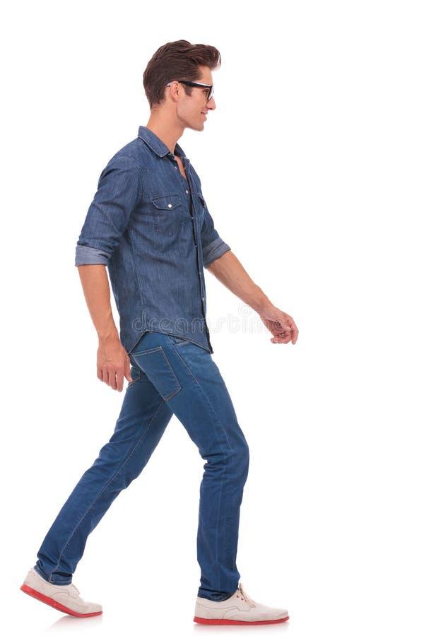 Side view of man walking stock image