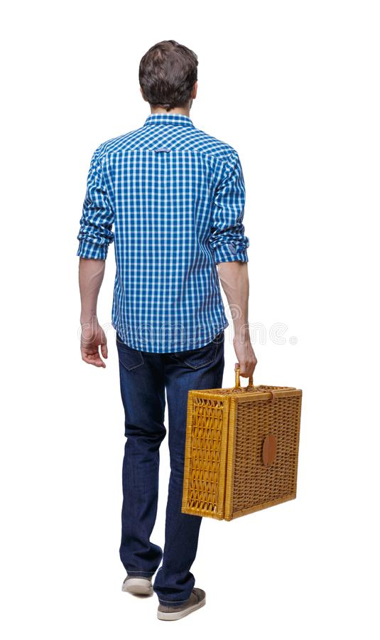 Side view of a man walking with a picnic bag stock images