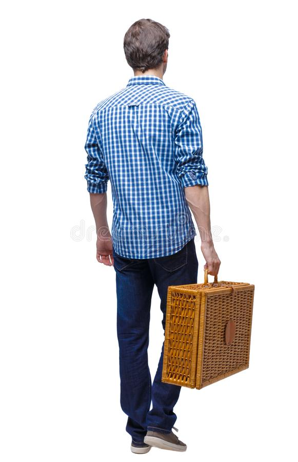 Side view of a man walking with a picnic bag royalty free stock photo
