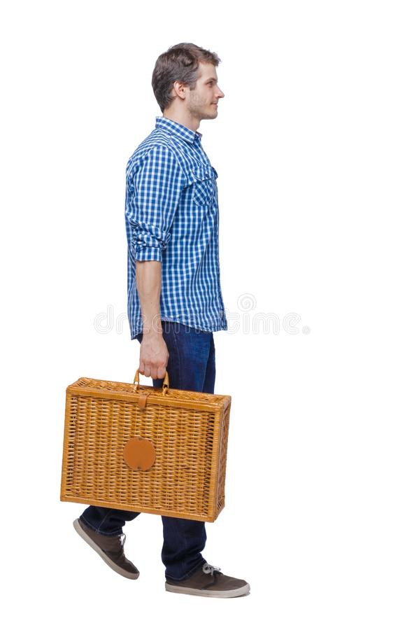 Side view of a man walking with a picnic bag stock photography
