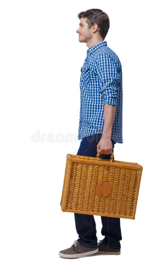 Side view of a man walking with a picnic bag stock photo