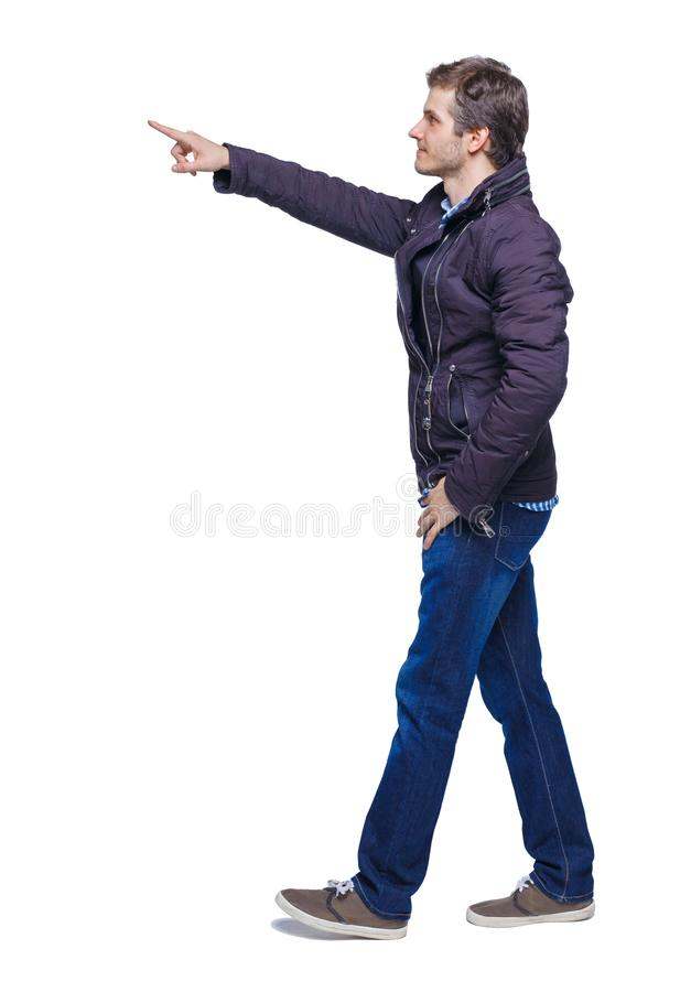 Side view of a man walking with a pointing hand royalty free stock image