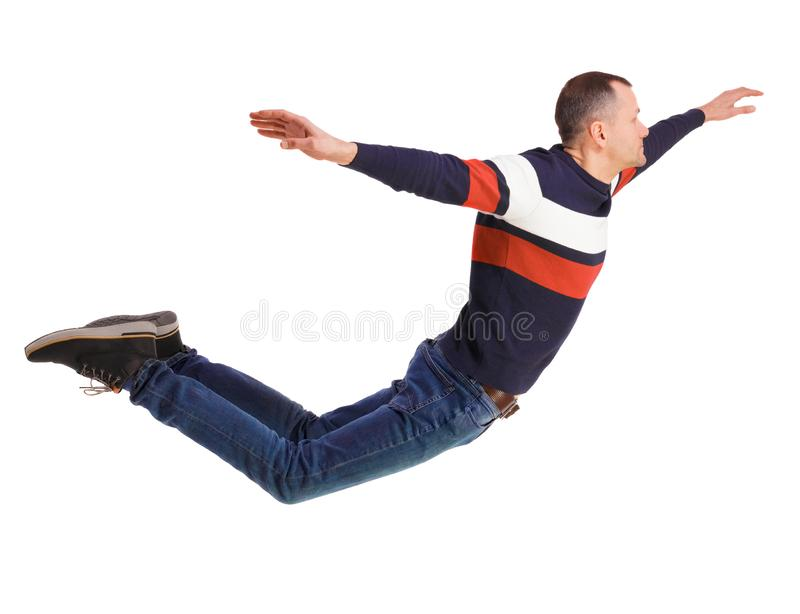 Side view of man in zero gravity or a fall royalty free stock image