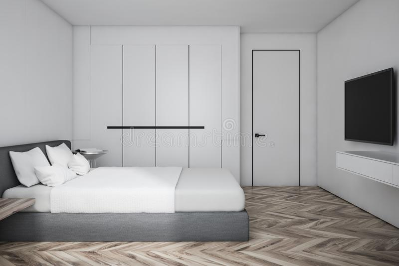 Side view of master bedroom with TV set. Side view of master bedroom with white walls, wooden floor, gray bed with TV set in front of it and white. Narrow door stock illustration