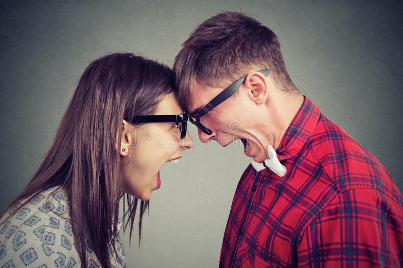 Screaming young couple having arguments royalty free stock images