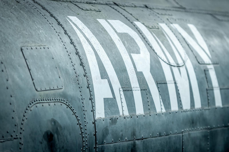 Side view of military plane with inscription. Close-up side view of military airplane with big white army inscription. Old war aircraft in metal plates royalty free stock photos