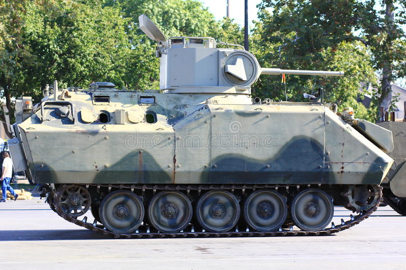 Side view of a military tank stock image