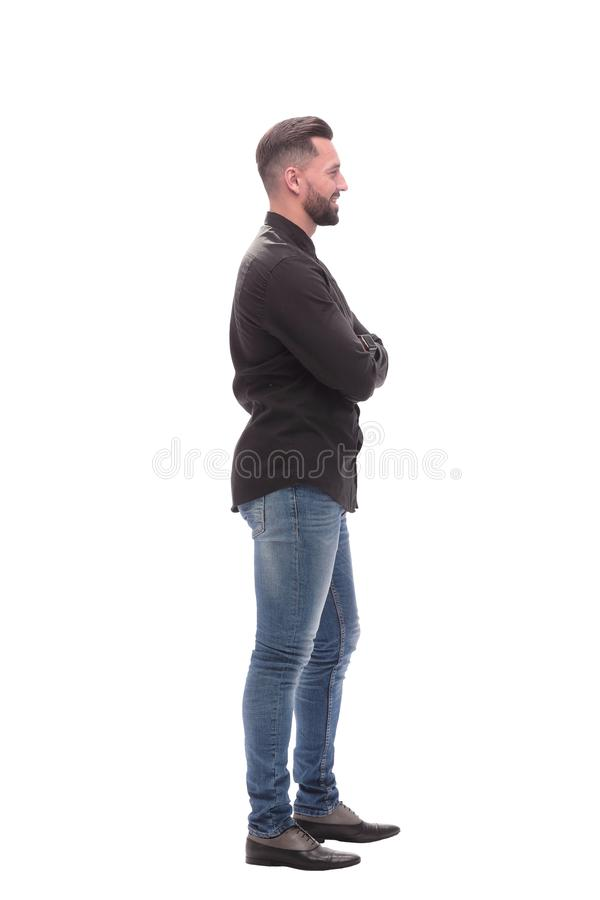 Side view. modern young man in jeans royalty free stock images