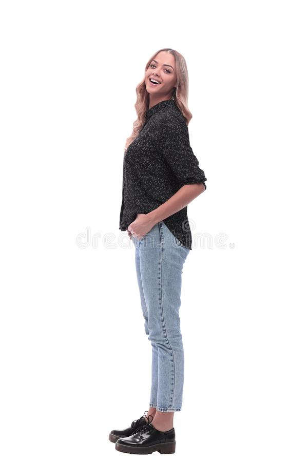 Side view. modern young woman in jeans and black blouse stock photo