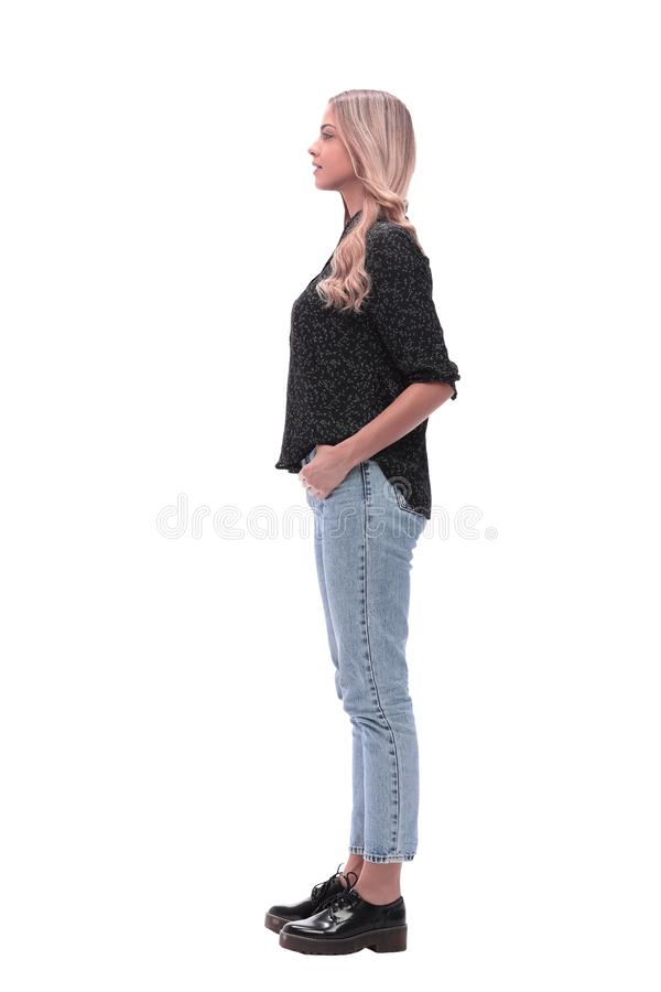 Side view. modern young woman in jeans and black blouse stock photos