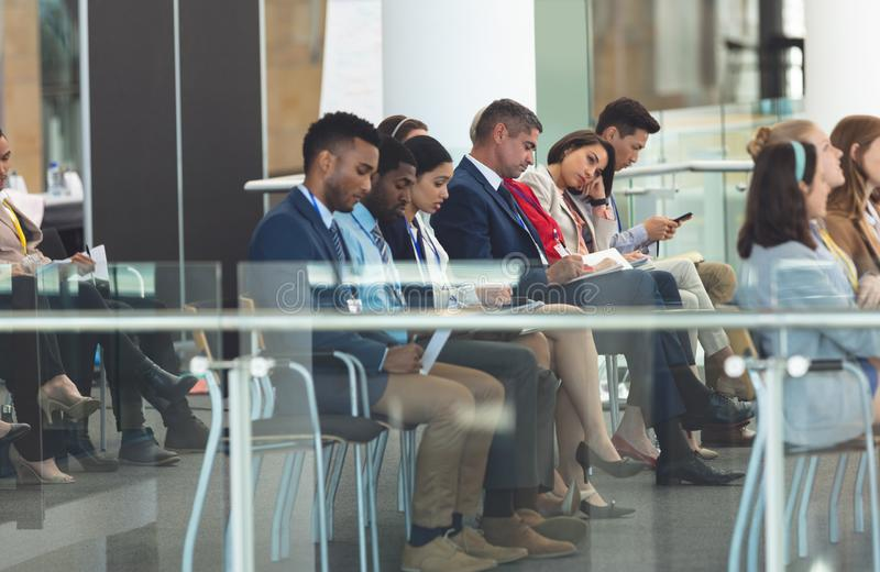 Business people attending a business seminar stock image