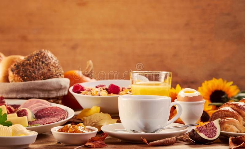Side view of multiple platters of food and drink stock photos