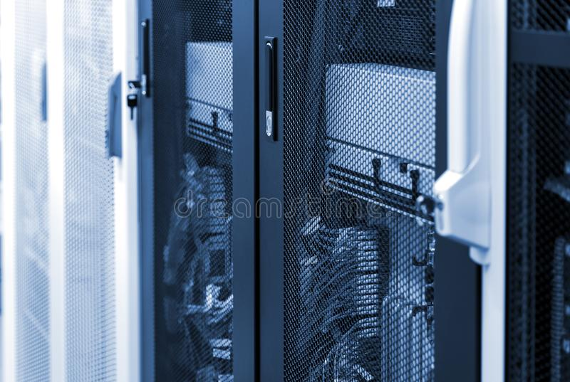 Side view network server room with racks in big data center. Datacentre interface and equipment. Networking and technology futuristic concept royalty free stock image