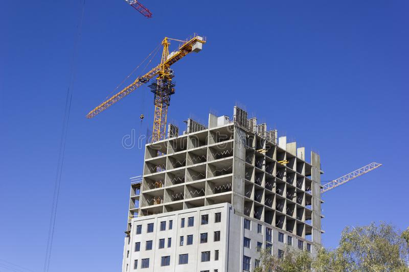 A new unfinished building with a construction crane royalty free stock images