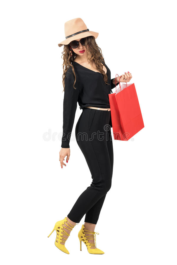Free Side View Of Walking Woman With Shopping Bag Turning Back Looking Down. Royalty Free Stock Photography - 69979837