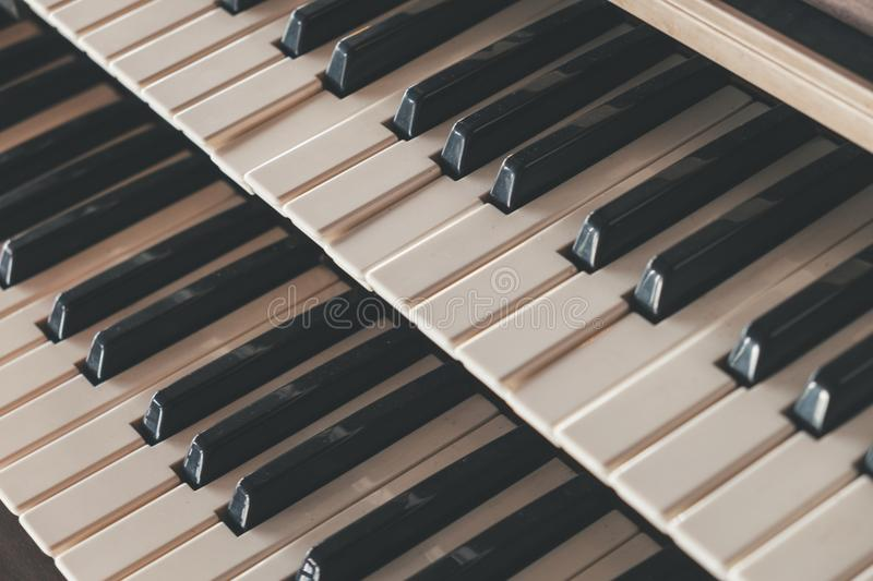 Side view old piano keyboard in cafe with old vintage tone stock images