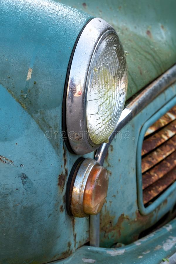 Side view of the popular Morris Minor 1000 vintage car. This car was also known as the `woody wagon` and is a British design icon. Side view of the once popular stock image