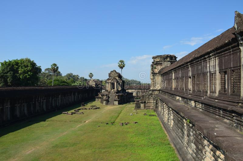Side view of one of the Angkor Wat buildings in the ancient temple complex of Angkor, Cambodia stock images