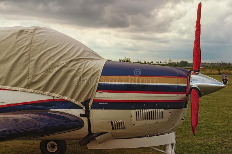 Side view of one engine airplane on a cloudy day. A small private airfield in Zhytomyr, Ukraine.  royalty free stock image