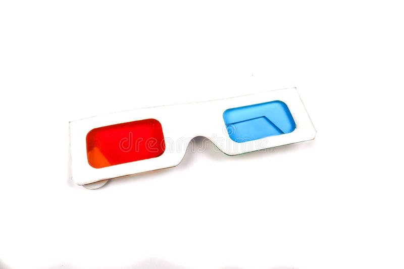 Side view of a pair of 3D glasses Isolated on white background. Cardboard, red, movie, blue, entertainment, fun, paper, film, theater, stereo, cinema, plastic stock images