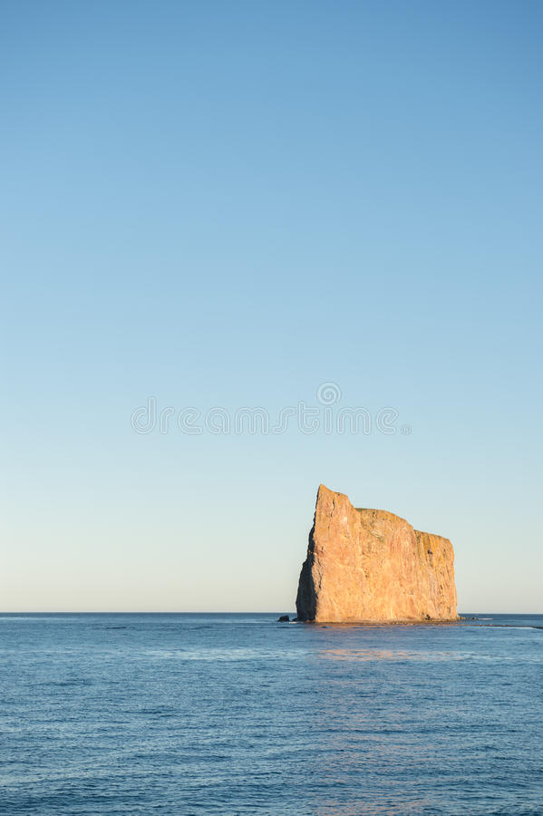 Side view of Perce Rock, Perce, Quebec, Canada stock photo