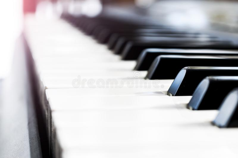 Side view of piano keys. Close-up of piano keys. Close frontal view. Piano keyboard with selective focus. Diagonal view. Piano key. Board perspective. Soft royalty free stock photos