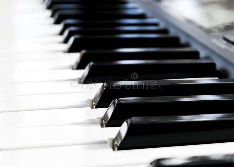 Side view of piano keys. Close-up of piano keys. Close frontal view. Piano keyboard with selective focus. Diagonal view. Piano key royalty free stock image