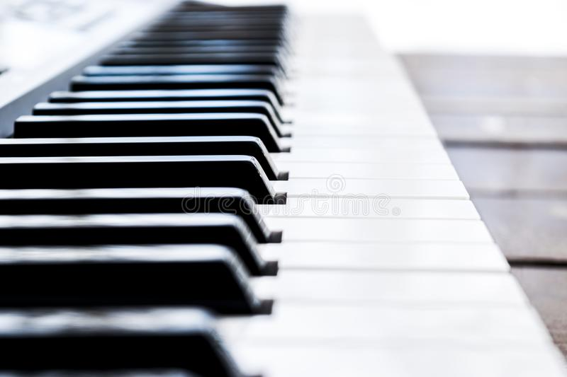 Side view of piano keys. Close-up of piano keys. Close frontal view. Piano keyboard with selective focus. Diagonal view. Piano key stock photos