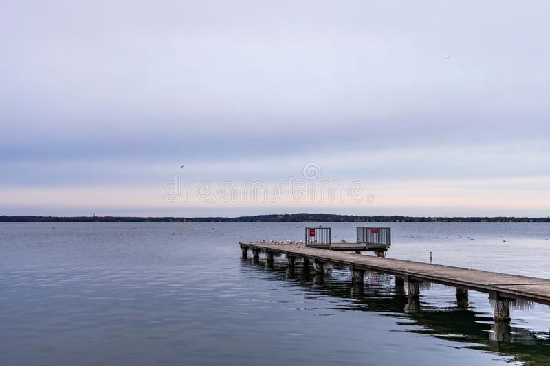 Side View of a Pier Extending out towards Lake Mendota in Madison Wisconsin stock photos