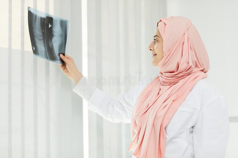 Middle-Eastern Female Doctor Holding X Ray stock photo