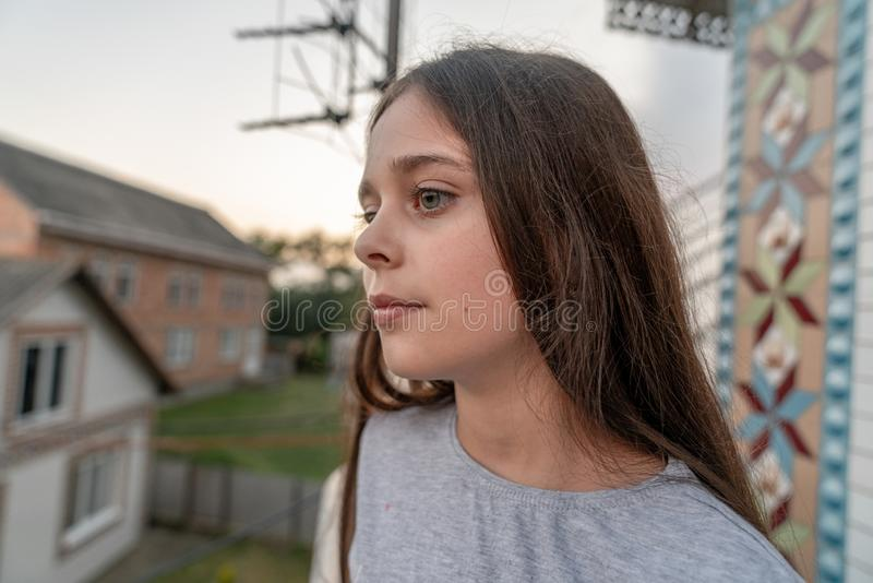 Side view portrait of cheerful young girl with long brunette hair looking away stock photos