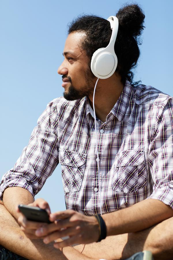 Contemporary Man Listening to Music in Summer stock images