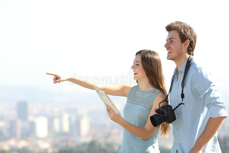 Happy tourists sightseeing in a city outskirts stock photos