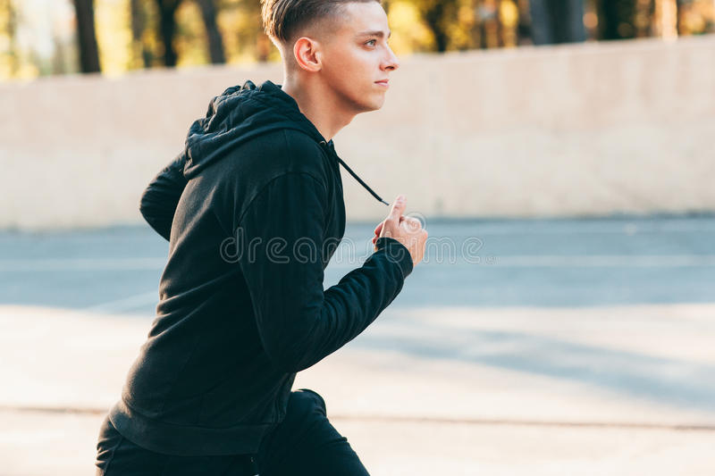Side view portrait of exercising man outside royalty free stock images