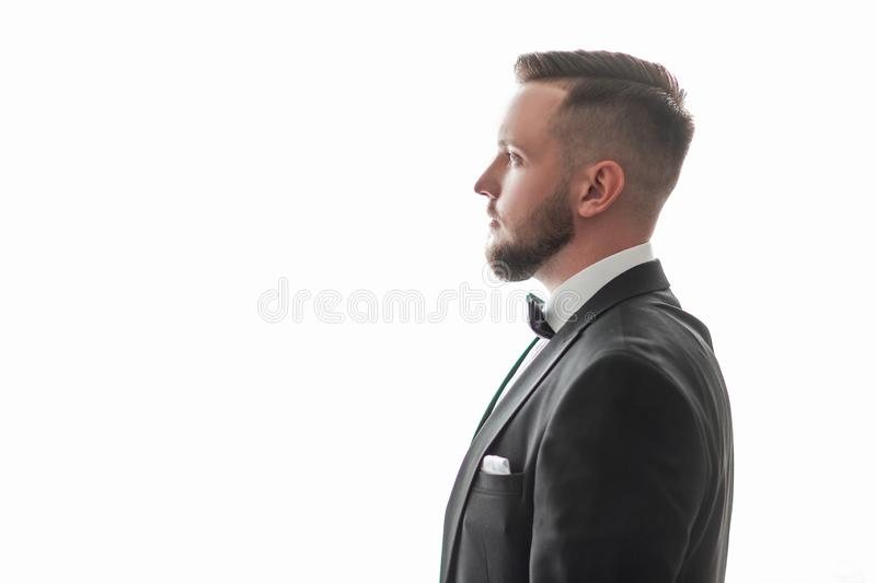 Side view. portrait of a handsome man with a bow tie. stock photos