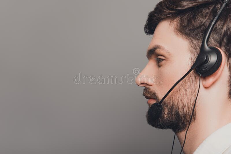 Side view portrait of handsome young man in headphones stock images