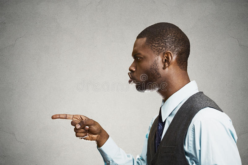 Side view portrait man pointing at someone accusing in wrong doing royalty free stock image