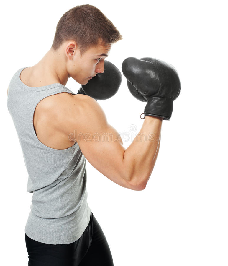 Side view portrait of muscular young boxer man stock image