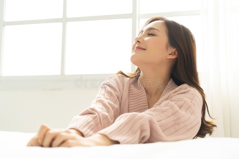 Side view portrait of a relaxed girl in the living room at home stock photography