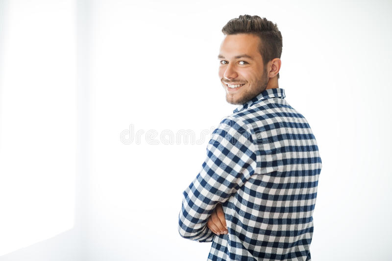 Side view portrait of smiling handsome man on white background stock image