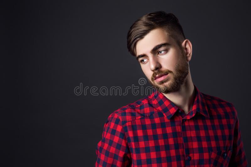 Side view portrait of stylish young man looking away royalty free stock images