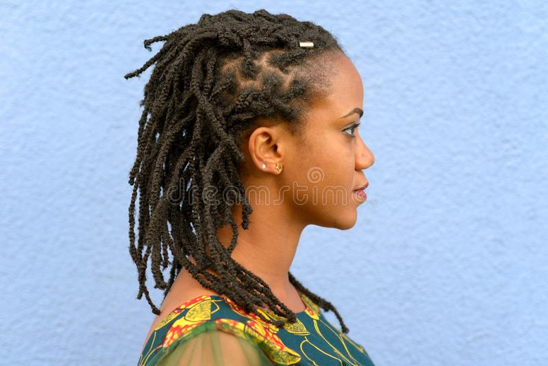 Side view portrait of a woman with dreadlocks stock photo