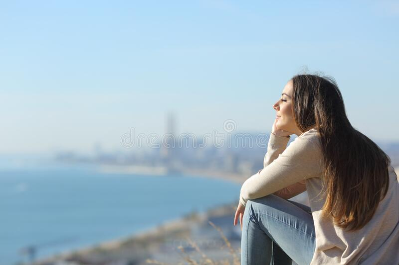 Woman meditating relaxing sitting outdoors royalty free stock photos